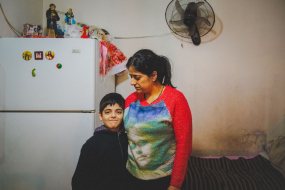 Montaha with her son  Dany in their precarious housing, Christian Iraqi refugees, Beirut, Lebanon
