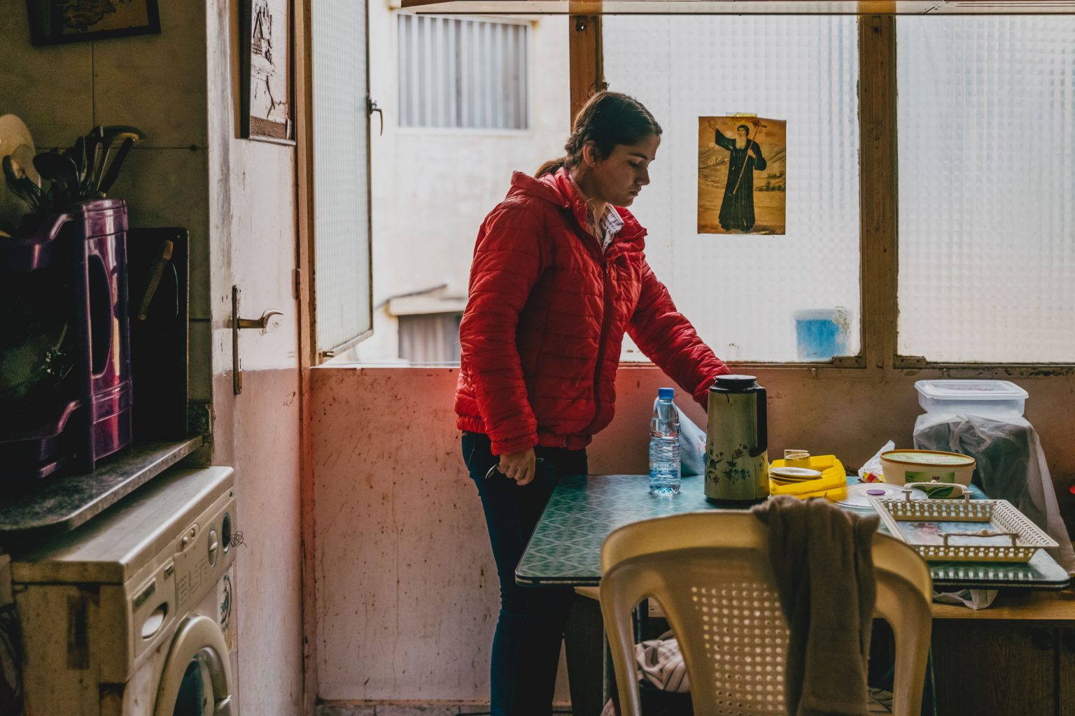 FORCES TO FLEE DAESH: CHRISTIAN  REFUGEE IN THE COLLECTIVE KITCHEN SHARED WITH ANOTHER IRAQI FAMILY, BEIRUT, LEBANON