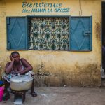 SOLANGE PARADIS PHOTOGRAPHY -A FEMALE SELLER IN CONAKRY STREETS FAR FROM HUMOURLESS. SOLANGE PARADIS PHOTOGRAPHY. DIGGING OUT OVERLOOKED TOPICS, PLACES AND PEOPLE.