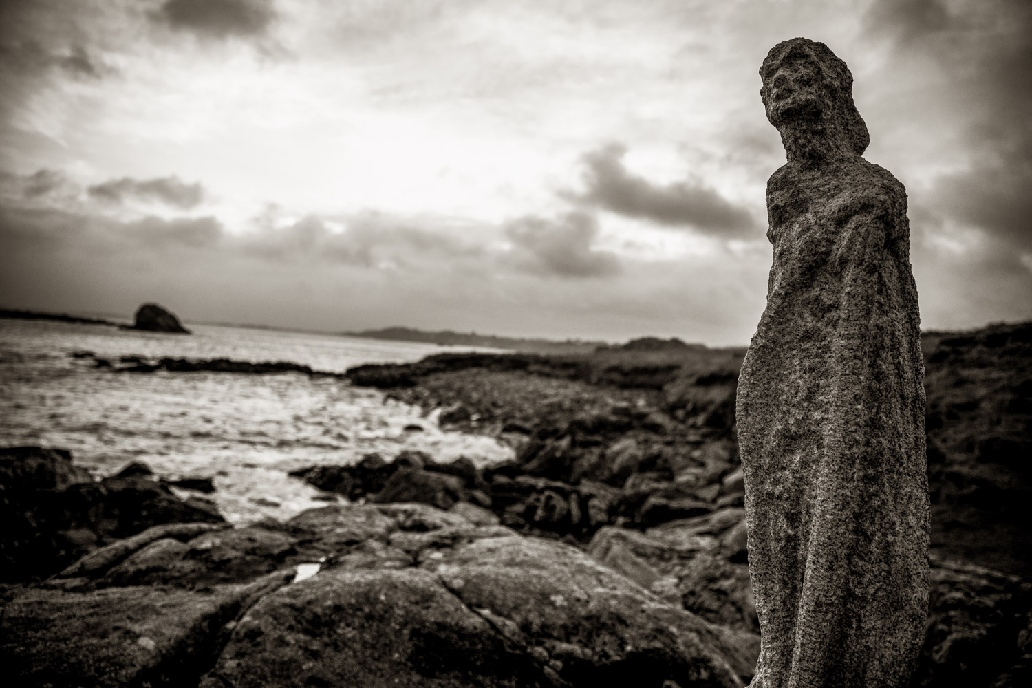 FEATURED AS A WOMAN, SAINT-TARIEC STATUE WAS ERECTED BY FAÑCH BRETON TO PROTECT THE CALVARY FROM THE SEA