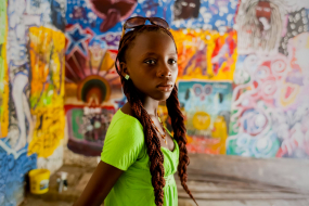 Young Haitian earthquake survivor during a painting class